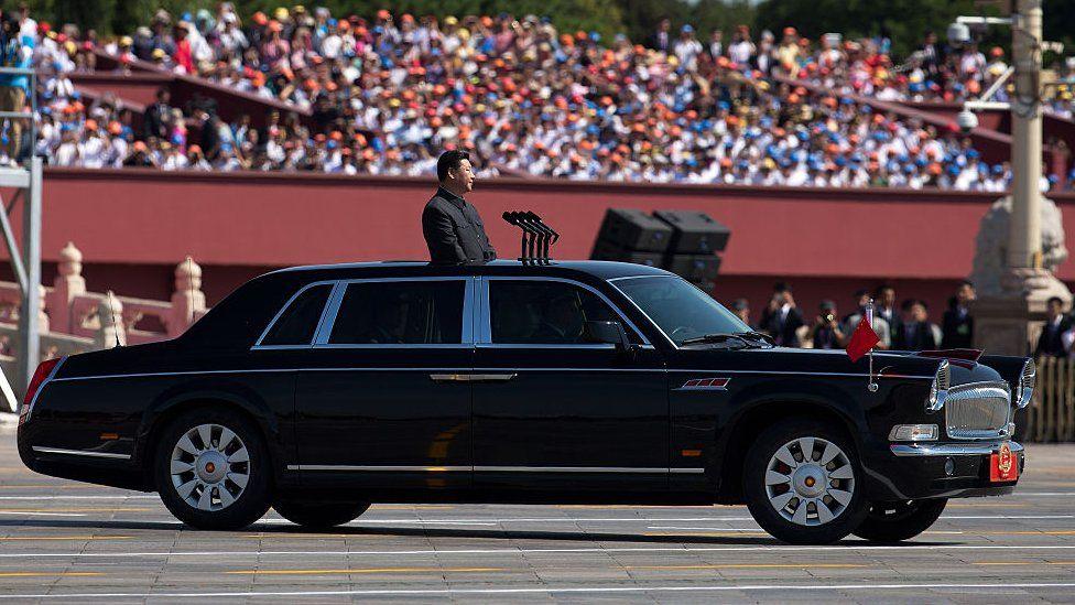 Xi Jinping in a FAW Hongqi at a military parade.
