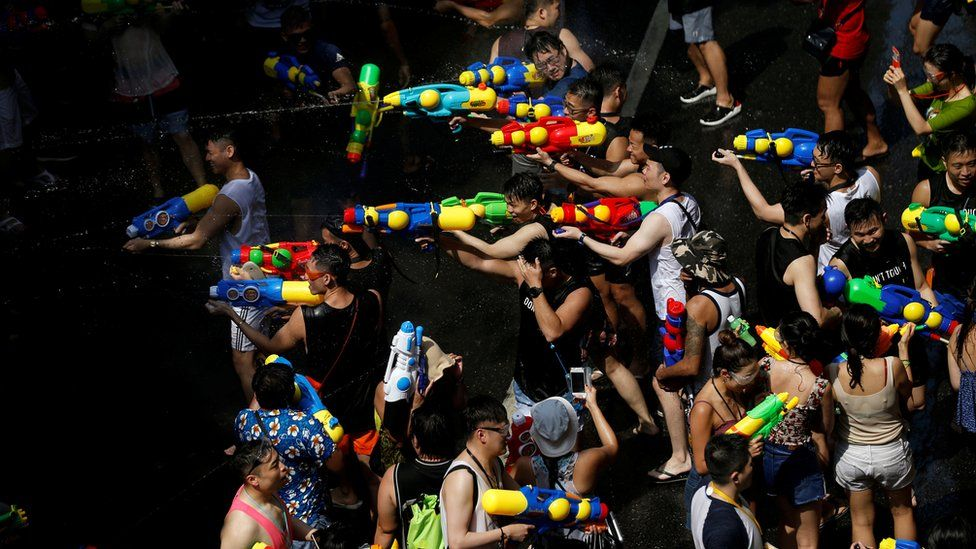 People play with water pistols to celebrate the water festival