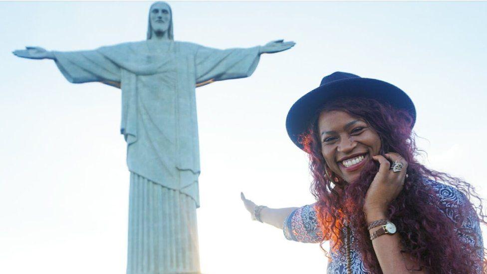 Gloria points to the Jesus statue in Rio de Janiero