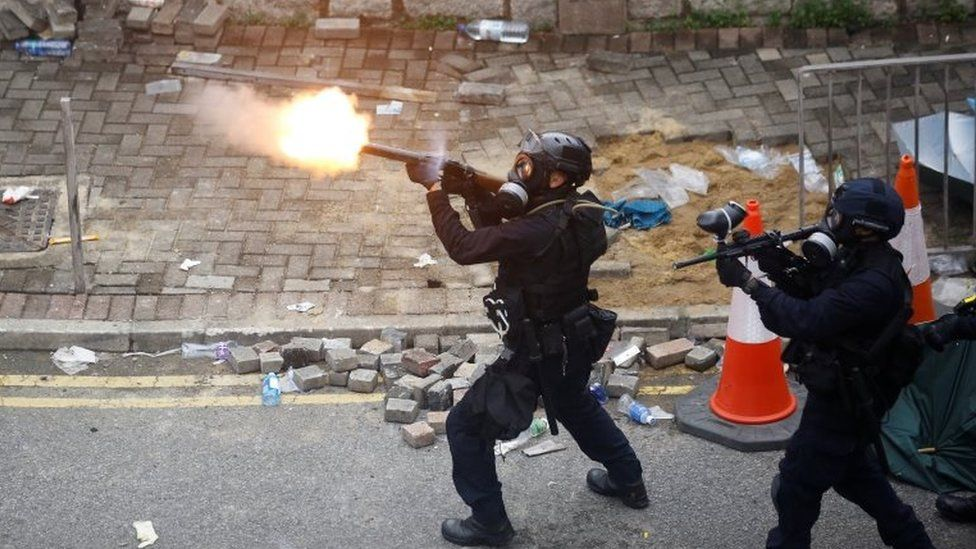 Hong Kong police fire tear gas at a protest in 2019
