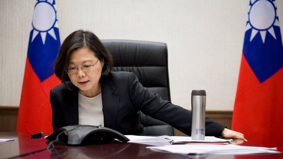 """Taiwan""""s President Tsai Ing-wen speaks on the phone with U.S. president-elect Donald Trump at her office in Taipei, Taiwan, in this handout photo made available December 3, 2016."""