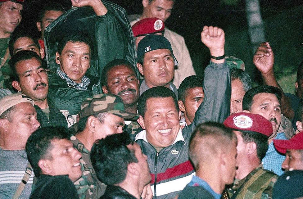 Venezuelan President Hugo Chavez returns to office two days after he was ousted from the Palace of Miraflores and arrested by the military in Caracas, Venezuela on April 13, 2002 - Thousands of protestors still thronged the streets, but in a first step toward reconciliation Chavez made conciliatory moves toward the state oil monopoly (Photo by Pedro RUIZ/Gamma-Rapho via Getty Images)
