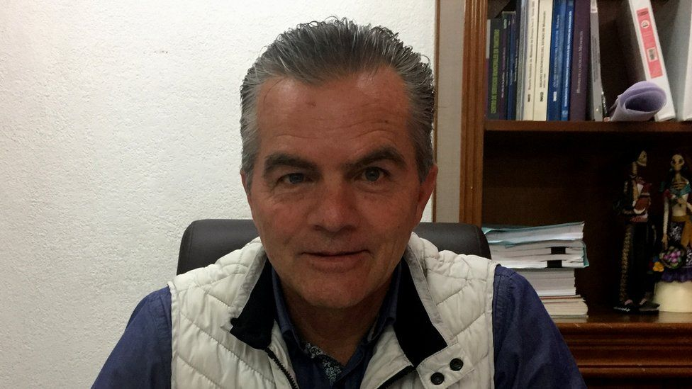 Arturo Olivera Gutiérrez in his office