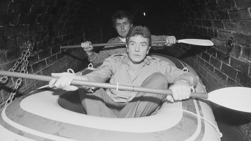 Finney and Martin Sheen filming on a boat