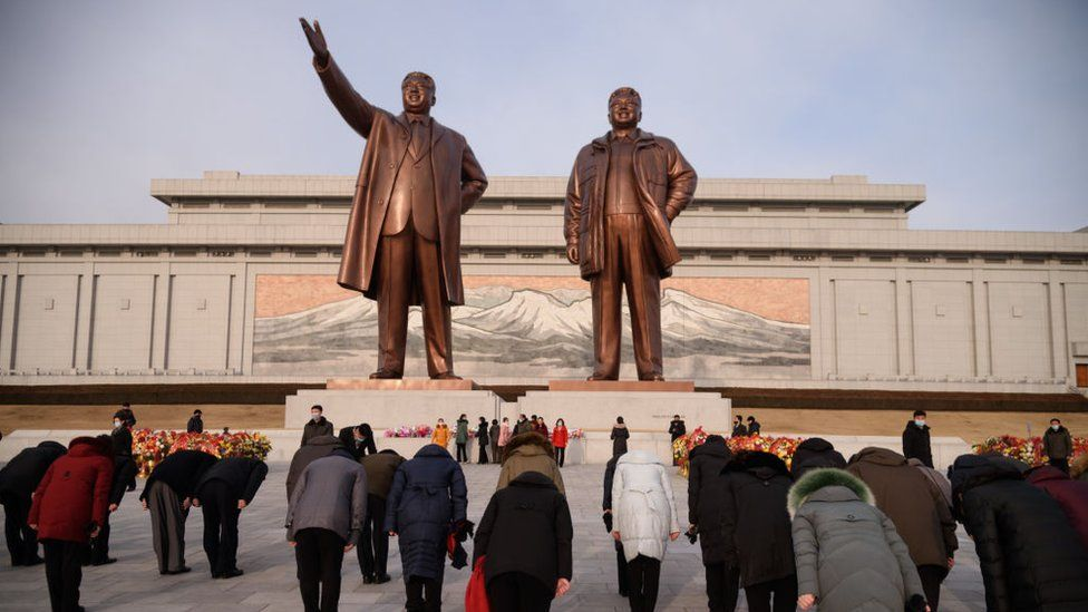 People visit the statues of late North Korean leaders Kim Il Sung and Kim Jong Il on the occasion of the 79th birth anniversary of Kim Jong Il, known as the 'Day of the Shining Star', at Mansu Hill in Pyongyang on February 16, 2021.