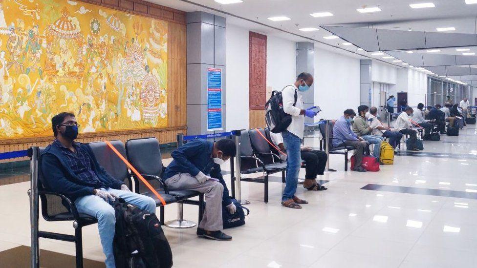 Evacuees from Dubai at the Calicut airport in Kerala