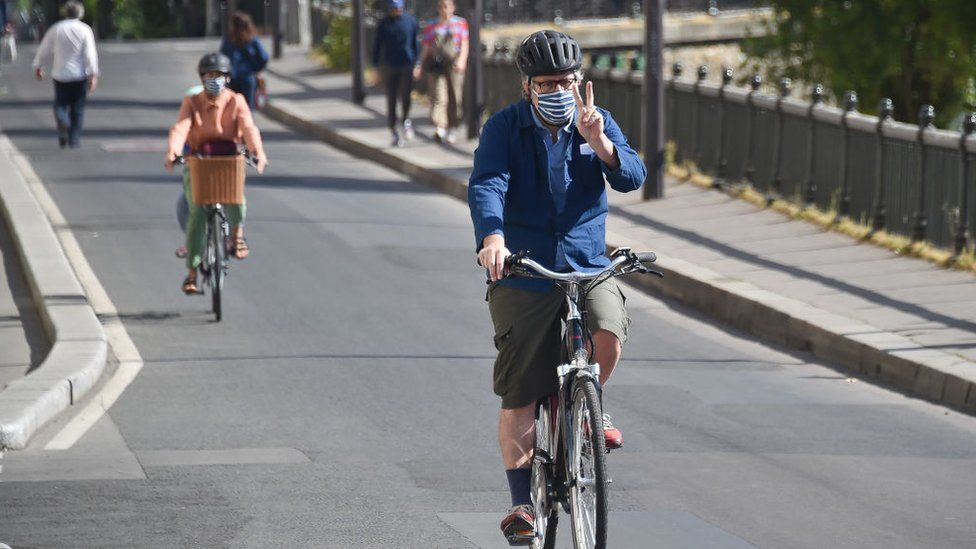 Cyclists in Paris wearing face masks during the coronavirus lockdown