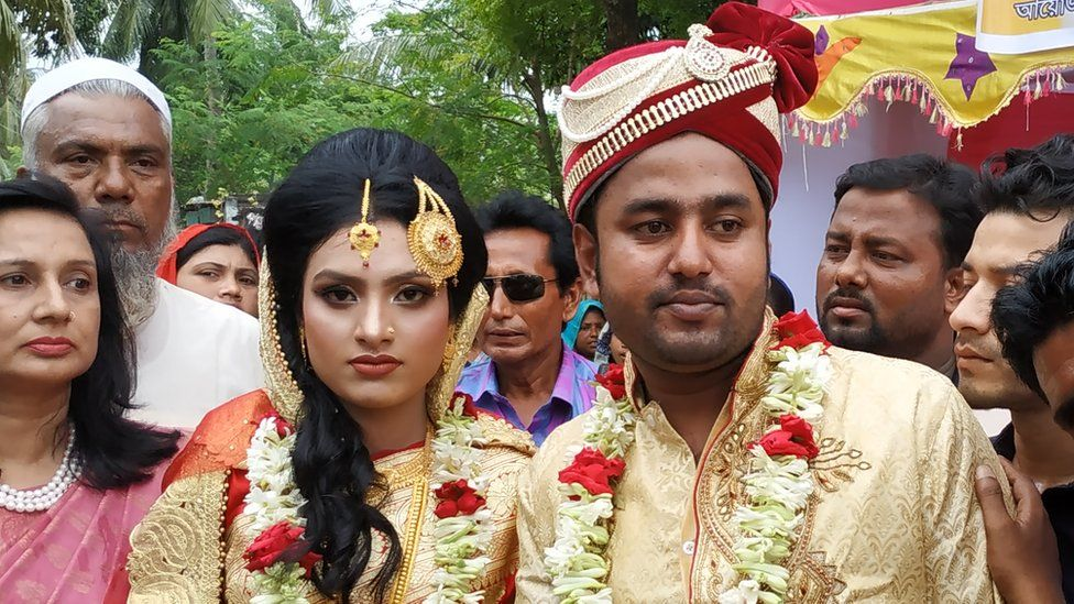 Tariqul Islam (right) and bride Khadiza Akter Khushi pose for a photo during their wedding in Meherpur