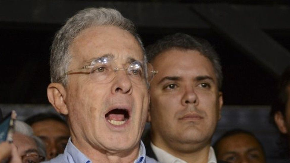 Opposition Senator and former President Alvaro Uribe reads a statement at his house in Rionegro, Colombia, Sunday, Oct. 2, 2016. Colombians rejected a peace deal with leftist rebels by a razor-thin margin in a national referendum.