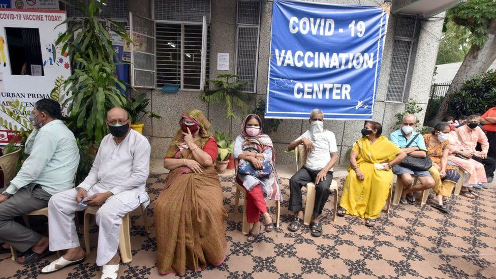People waiting in line for vaccination in India