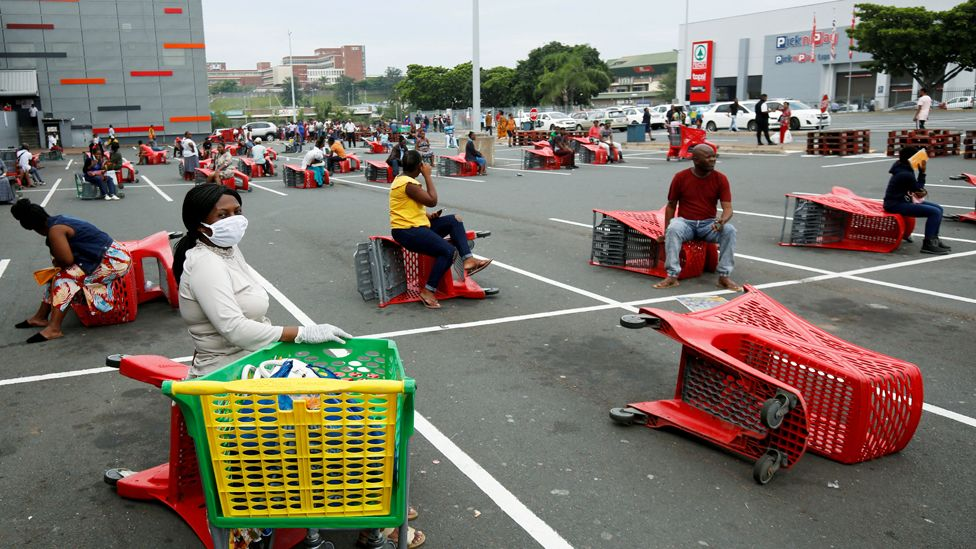Shoppers sitting on trolleys in Durban, South Africa -Wednesday 1 April 2020