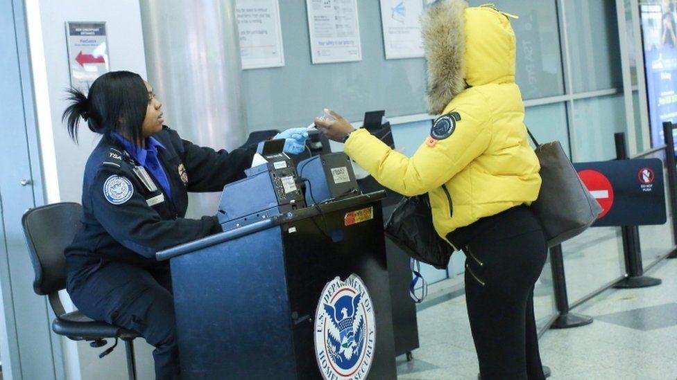 People being checked at TSA screening