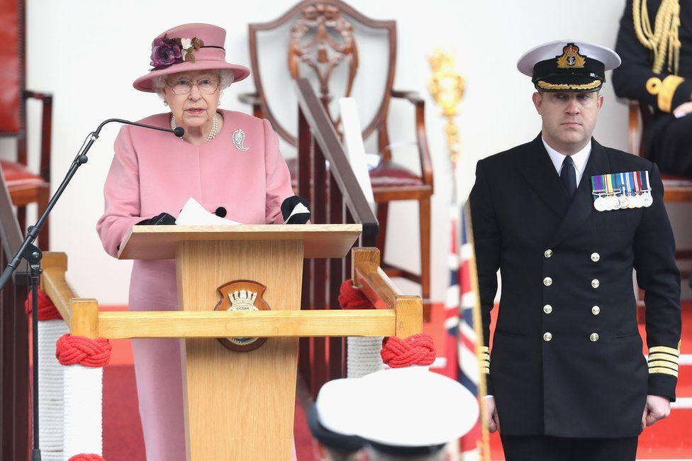 The Queen and Captain Robert Pedre, the commanding officer of HMS Ocean