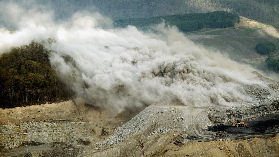 Image shows an explosive being detonated at a surface mining operation in the Appalachian Mountains