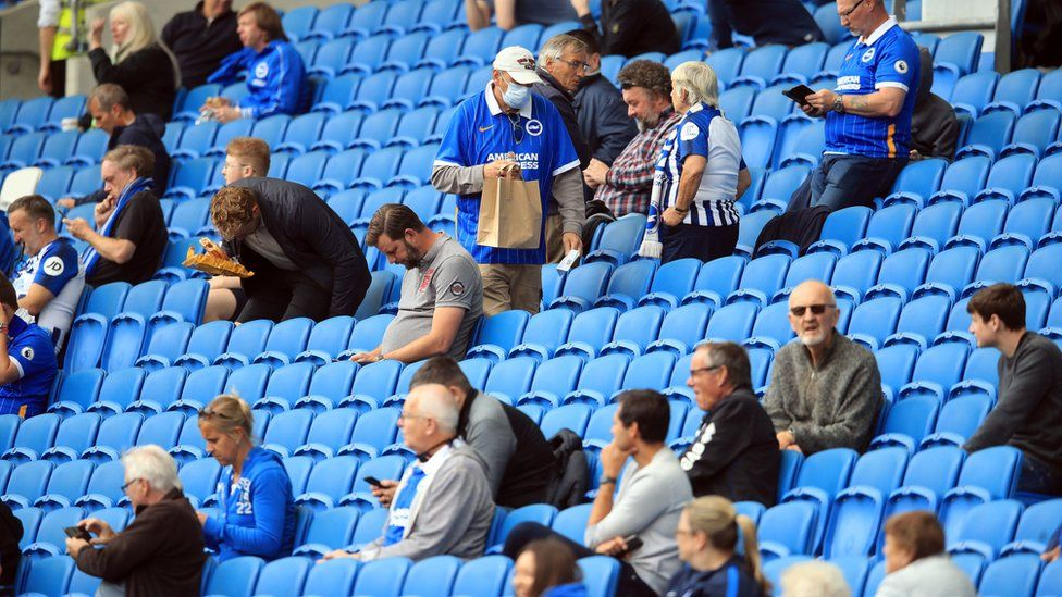 Photo dated August 2020 of Brighton and Hove Albion fans take their seats in the stands with social distancing measures before the pre-season friendly at the AMEX Stadium in Brighton