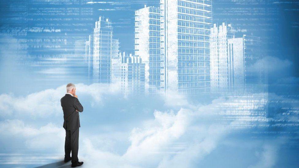 Man looking at a city
