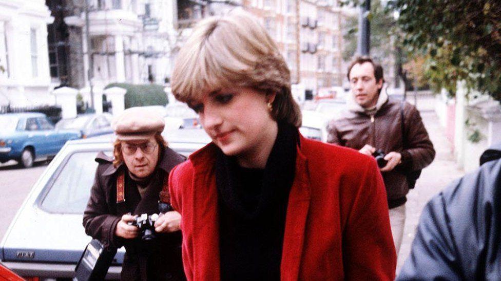 Diana followed by photographers