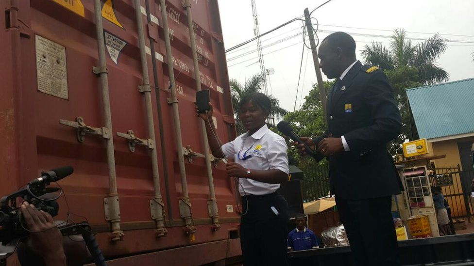 Custom official and man stand next to a cargo truck