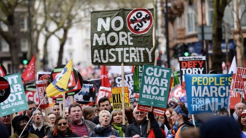 People in London protesting against government cuts