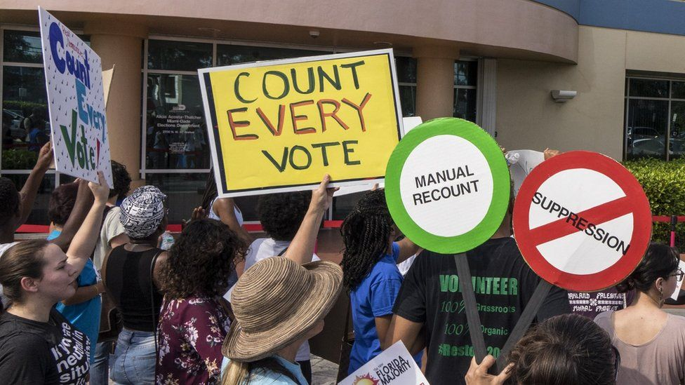 A crowd protests to demand a vote recount in Miami, Florida