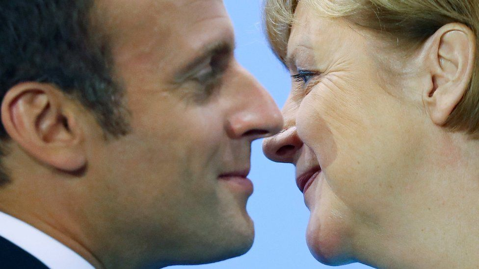 French President Emmanuel Macron and German Chancellor Angela Merkel attend the press conference after the meeting at the Chancellery in Berlin, Germany June 29, 2017