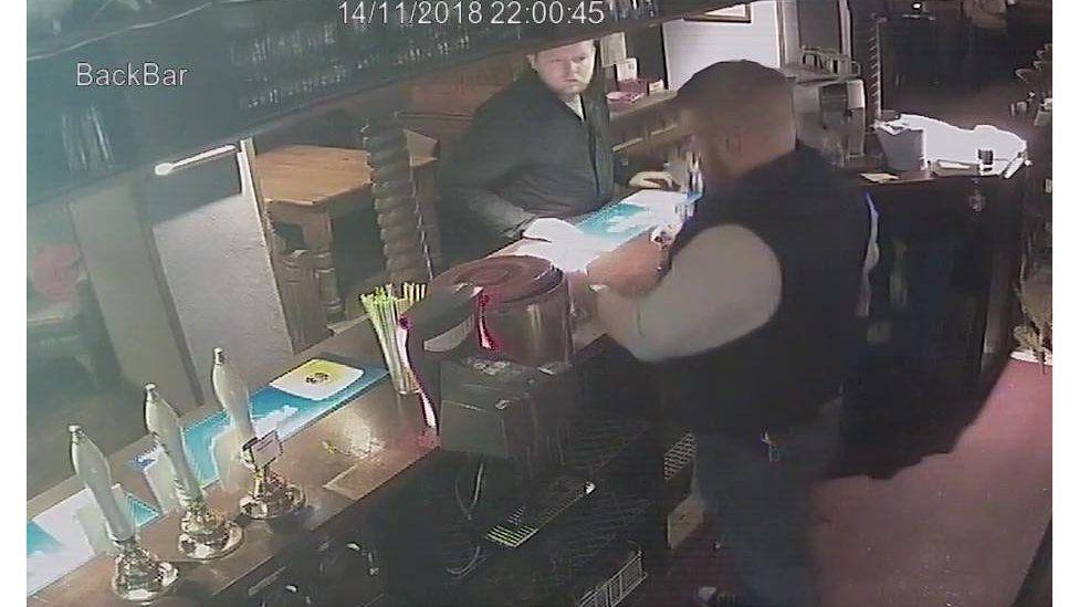Man in a pub on CCTV