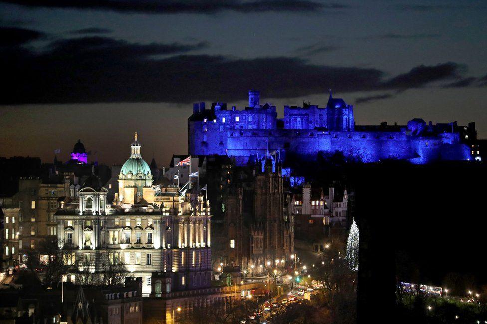 Edinburgh Castle is illuminated blue to mark St Andrew's Day.