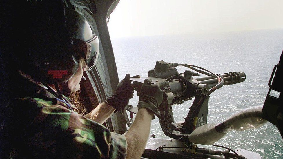 A Royal Navy helicopter patrols off the coast of Sierra Leone in May 2000