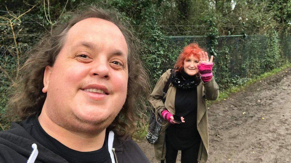 Simon Joyce and his mum Diane walking