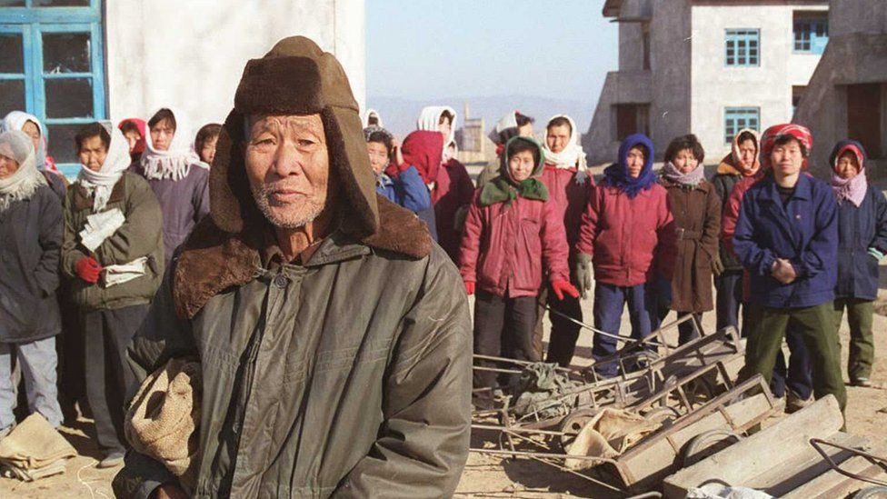 Residents of Taziri wait for Red Cross food supplies in December 1995 in North Korea