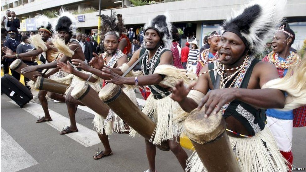 Traditional Chuka drummers celebrate as they welcome the national athletics team at the Jomo Kenyatta airport in Nairobi