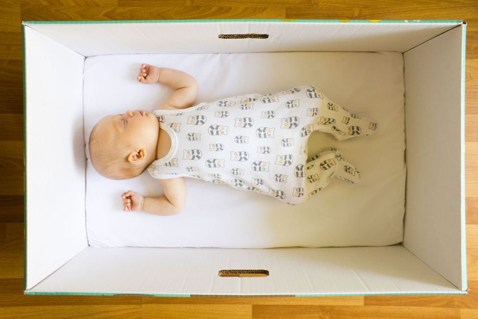 Baby asleep in baby box