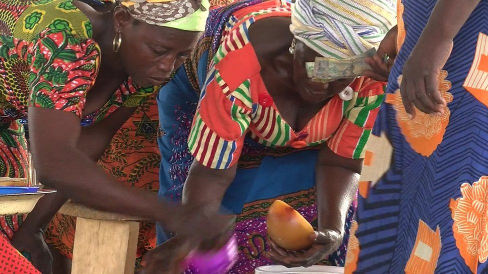 Shea butter makers at market in Anateem, Ghana