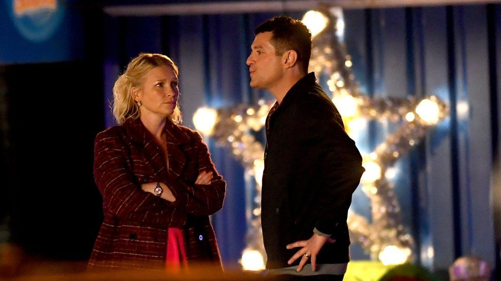 Matthew Horne and Joanna Page film in front of a giant illuminated Christmas star