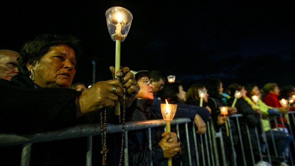 """Devotees holding candles participate at the traditional candles procession at Fatima""""s Sanctuary, Portugal, 12 May 2017"""