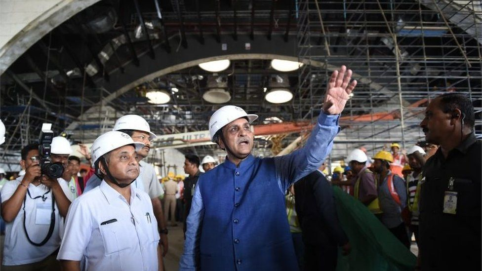 """Gujarat's Chief Minister Vijaybhai Rupani (C) gestures next to Gujarat""""s Deputy Chief Minister Nitinbhai Patel (L) during their visit to the Statue Of Unity on 25 August 2018"""
