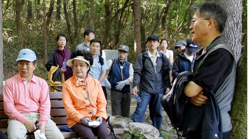 Mr Moon, then presidential chief of staff, climbing a mountain with then President Roh Moo-hyun.