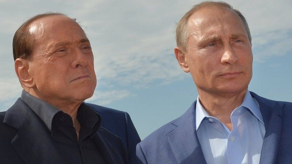 Russian President Vladimir Putin (right) and former Italian Prime Minister Silvio Berlusconi visit an Italian war cemetery near the Black Sea port of Sevastopol (11 September 2015)