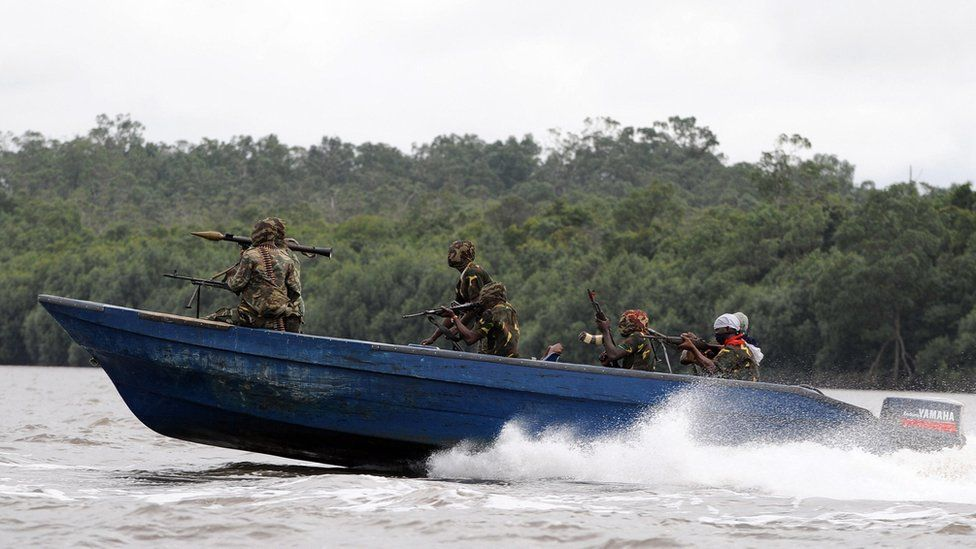 Fighters with the Movement for the Emancipation of the Niger Delta (MEND) head off for an operation against the Nigerian army in Niger Delta on September 17, 2008.