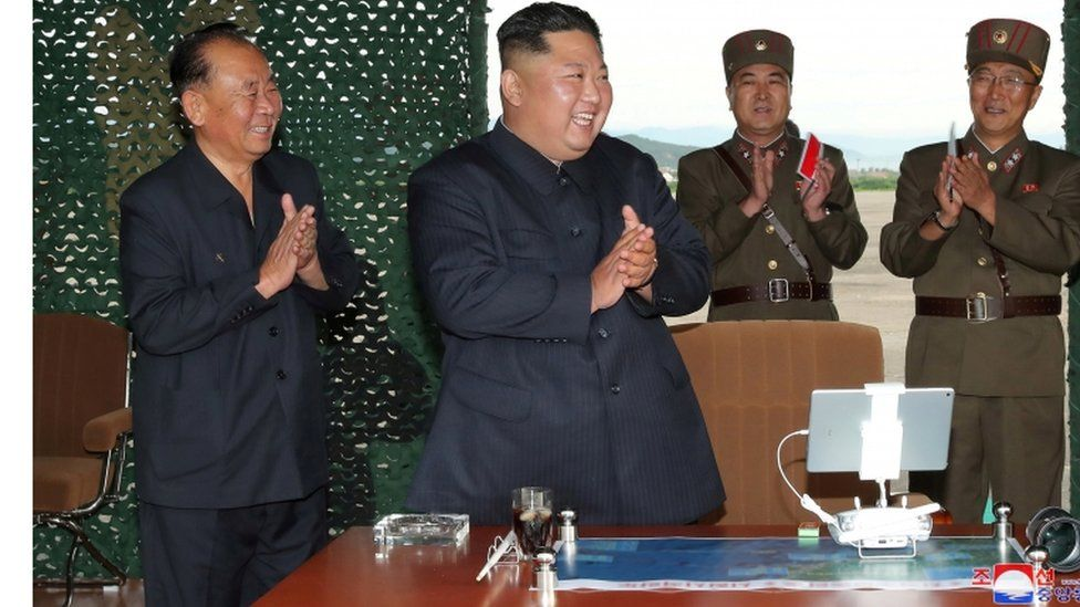 North Korean leader Kim Jong-un applauds as he observes missile test, 24 August 2019