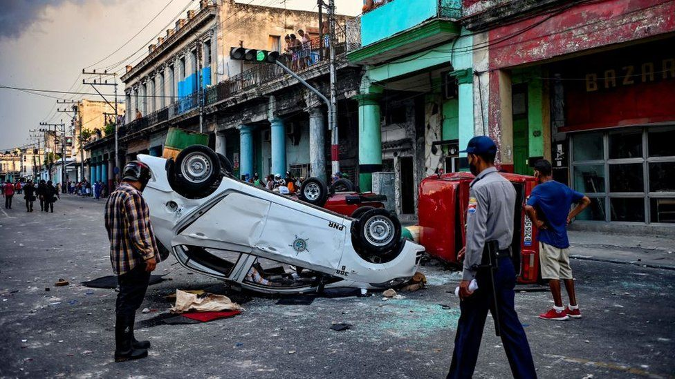 Cars overturned by protesters in Havana, July 2021