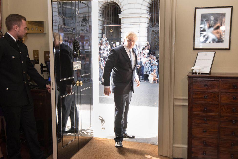 Boris Johnson enters 10 Downing Street