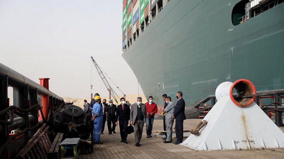 Egyptian officials inspect the operation to refloat the Ever Given ship