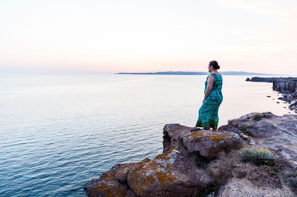 Chiara Vigo standing on the cliff