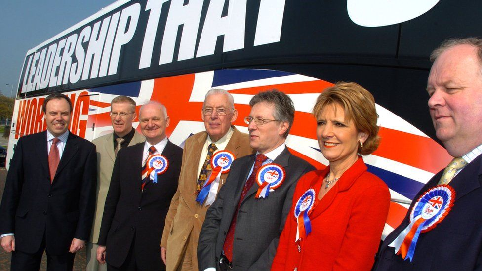 DUP leader Ian Paisley with party colleagues Nigel Dodds, Gregory Campbell, William McCrea, Peter Robinson, Iris Robinson and Jimmy Sprat beside the party's election battle bus in 2005
