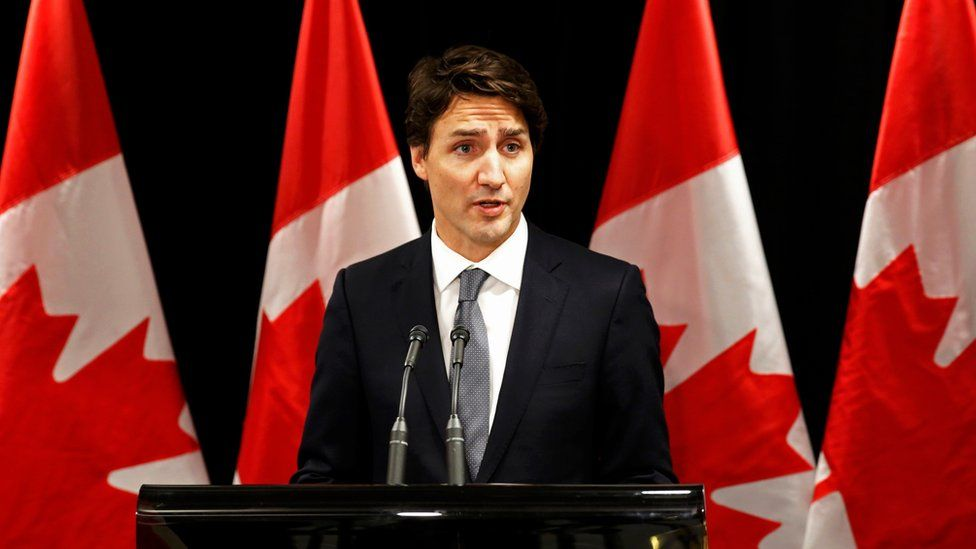 Canadian Prime Minister Justin Trudeau speaks about a Saskatchewan school shooting during a news conference in Davos, January 22, 2016.
