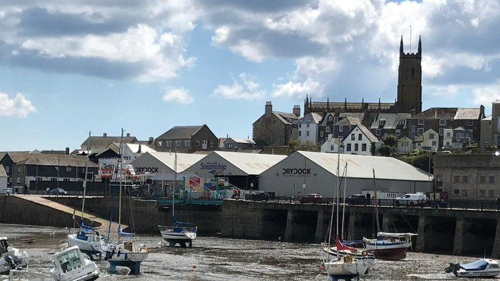 View of Penzance harbour with dry dock at low tide
