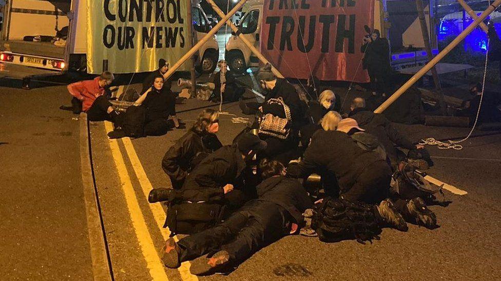 Protesters at a blockade near a printing press