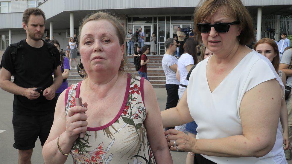 Galina Timchenko (R), CEO of online news portal Meduza, escorts Svetlana, mother of Russian investigative journalist Ivan Golunov, in Moscow, 8 June