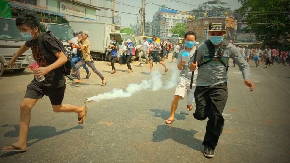 Security forces intervene in protesters as they gather to protest against the military coup in Yangon